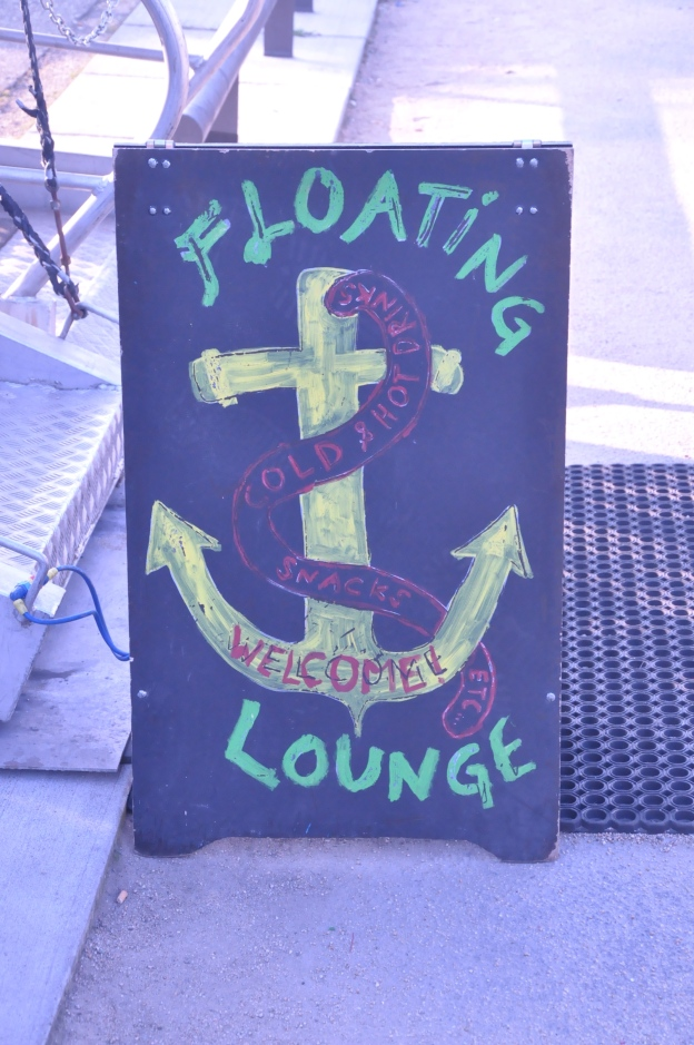 Outside a floating hostel and bar