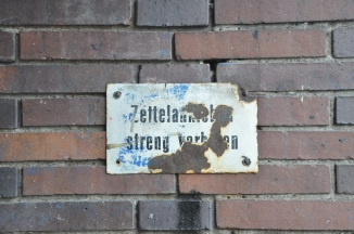 An original sign under the bridge leading to the stadium